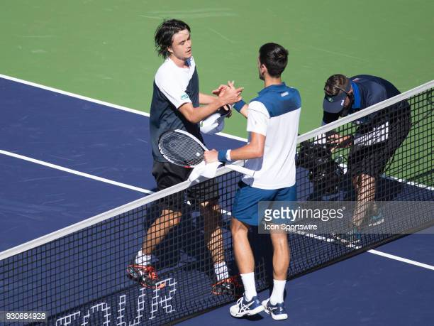 Taro Daniel shakes hands with Novak Djokovic after defeating Djokovic in the men's singles during the BNP Paribas Open on March 11 at the Indian...