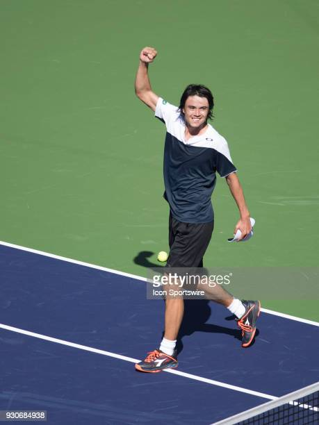 Taro Daniel waves to fans after defeating Novak Djokovic in the men's singles during the BNP Paribas Open on March 11 at the Indian Wells Tennis...