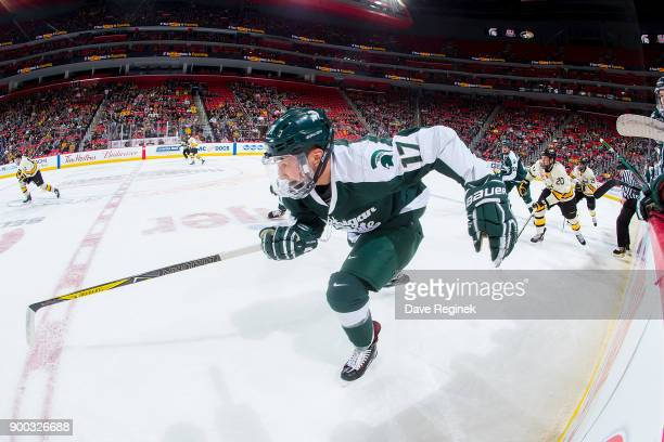 Taro Hirose of the Michigan State Spartans skates up ice against the Michigan Tech Huskies during game one of the Great Lakes Invitational Hockey...