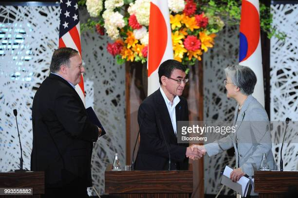 Taro Kono Japan's foreign minister center shakes hands with Kang KyungWha South Korea's foreign minister right as Mike Pompeo US secretary of state...