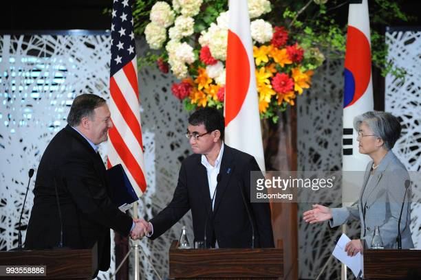 Taro Kono Japan's foreign minister center shakes hands with Mike Pompeo US secretary of state left as Kang KyungWha South Korea's foreign minister...