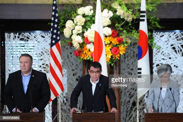Taro Kono Japan's foreign minister center speaks as Mike Pompeo US secretary of state left and Kang KyungWha South Korea's foreign minister listen...