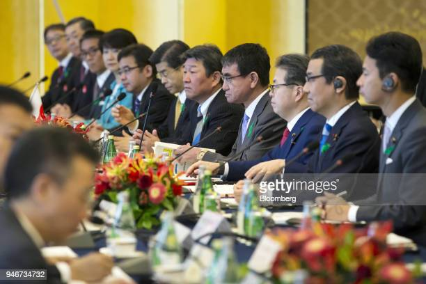 Taro Kono Japan's foreign minister fourth from right attends a highlevel JapanChina economic dialogue with China's foreign minister Wang Yi not...