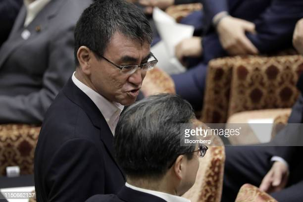 Taro Kono Japan's foreign minister left attends a party leaders' debate at the lower house of parliament in Tokyo Japan on Wednesday June 19 2019...