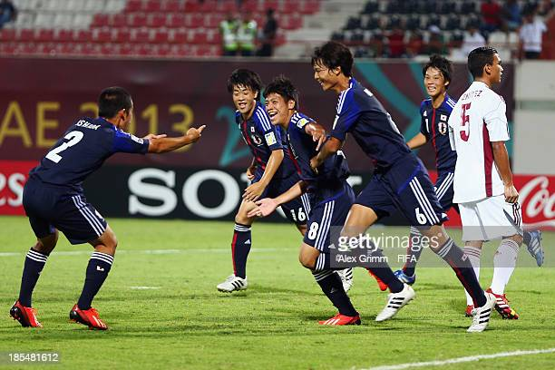 Taro Sugimoto of Japan celebrates his team's first goal during the FIFA U-17 World Cup UAE 2013 Group D match between Japan and Venezuela at Sharjah...