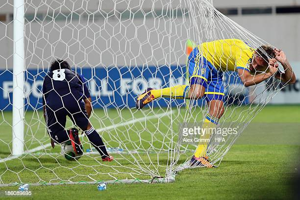 Taro Sugimoto of Japan gets the ball out of the goal as Linus Wahlqvist of Sweden reacts after scoring an own goal during the FIFA U17 World Cup UAE...