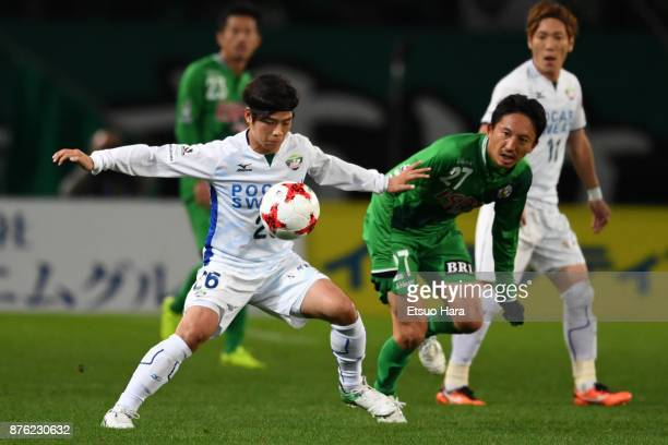 Taro Sugimoto of Tokushima Vortis and Hideo Hashimoto of Tokyo Verdy compete for the ball during the JLeague J2 match between Tokyo Verdy and...