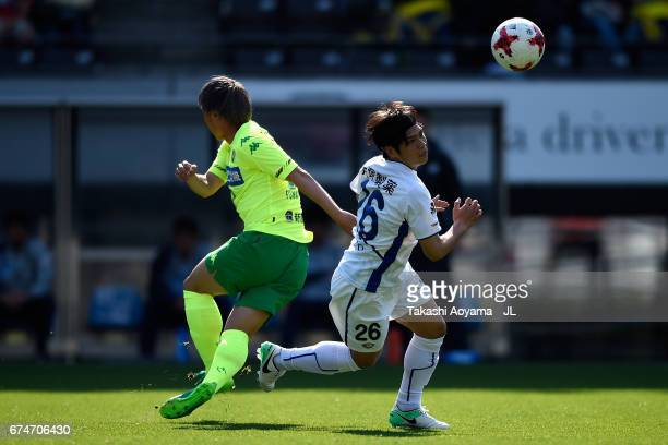 Taro Sugimoto of Tokushima Vortis and Takayuki Funayama of JEF United Chiba compete for the ball during the JLeague J2 match between JEF United Chiba...