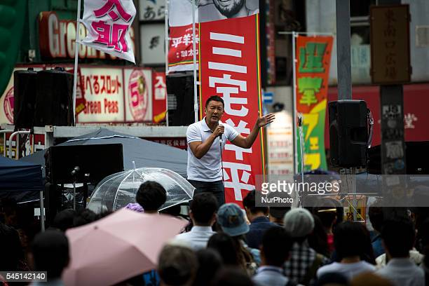 Taro Yamamoto delivers a campaign speech to support his candidate Yohei Miyake outside of Shinjuku Station during July's House of Councillors...