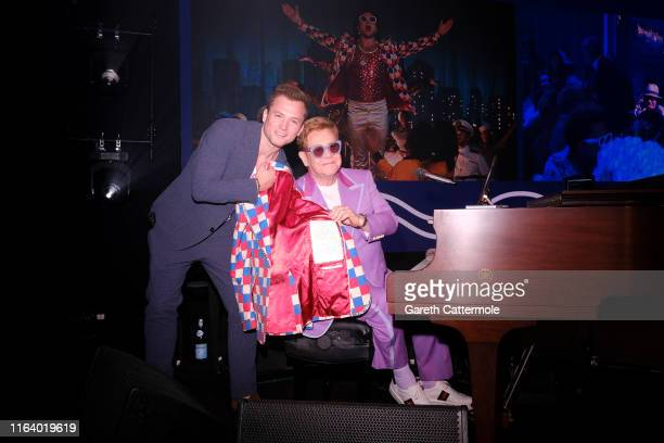 """Taron Egerton and Elton John attend the first """"Midsummer Party"""" hosted by Elton John and David Furnish to raise funds for the Elton John Aids..."""