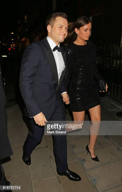 Taron Egerton and Emily Thomas arrives at the Dunhill GQ preBAFTA Filmmakers Dinner and Party Cohosted by Andrew Maag Dylan Jones at Bourdon House on...