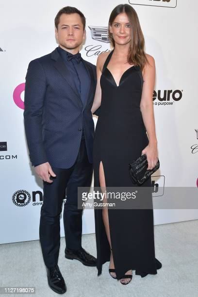 Taron Egerton and Emily Thomas attend the 27th annual Elton John AIDS Foundation Academy Awards Viewing Party celebrating EJAF and the 91st Academy...