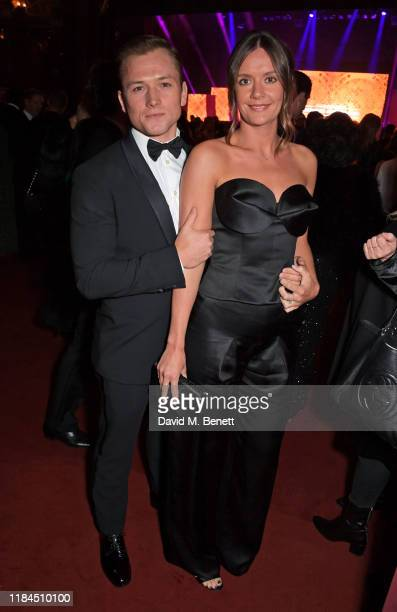 Taron Egerton and Emily Thomas attend the 65th Evening Standard Theatre Awards in association with Michael Kors at the London Coliseum on November 24...