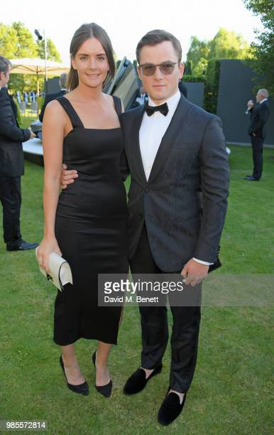 Taron Egerton and Emily Thomas attend the Argento Ball for the Elton John AIDS Foundation in association with BVLGARI Bob and Tamar Manoukian on June...
