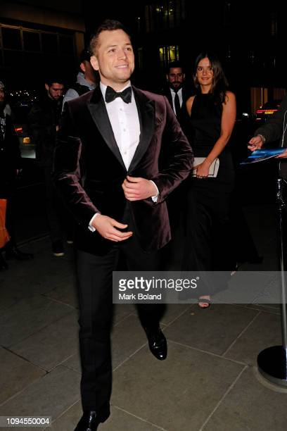 Taron Egerton and Emily Thomas attend the dunhill PreBAFTA dinner at dunhill Bourdon House on February 6 2019 in London England