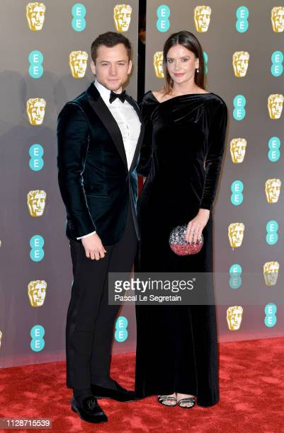 Taron Egerton and Emily Thomas attend the EE British Academy Film Awards at Royal Albert Hall on February 10 2019 in London England