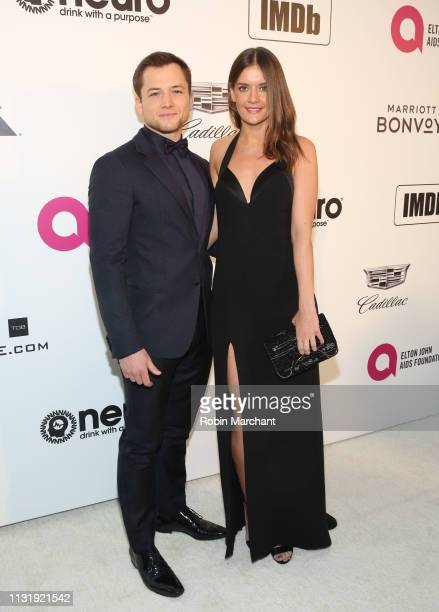 Taron Egerton and Emily Thomas attends 27th Annual Elton John AIDS Foundation Academy Awards Viewing Party Celebrating EJAF And The 91st Academy...