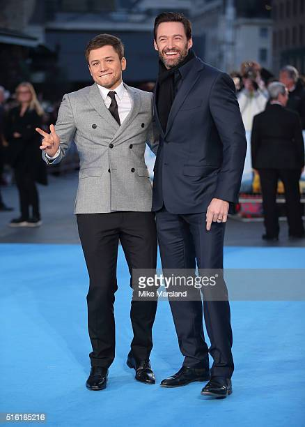 Taron Egerton and Hugh Jackman arrive for the European premiere of 'Eddie The Eagle' at Odeon Leicester Square on March 17 2016 in London England