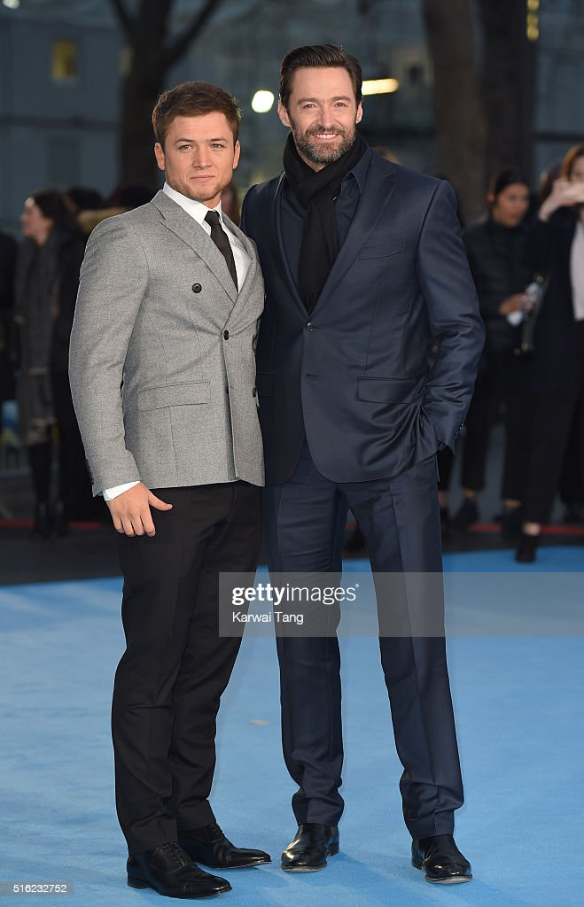 Taron Egerton and Hugh Jackman arrive for the European premiere of 'Eddie The Eagle' at Odeon Leicester Square on March 17, 2016 in London, England.