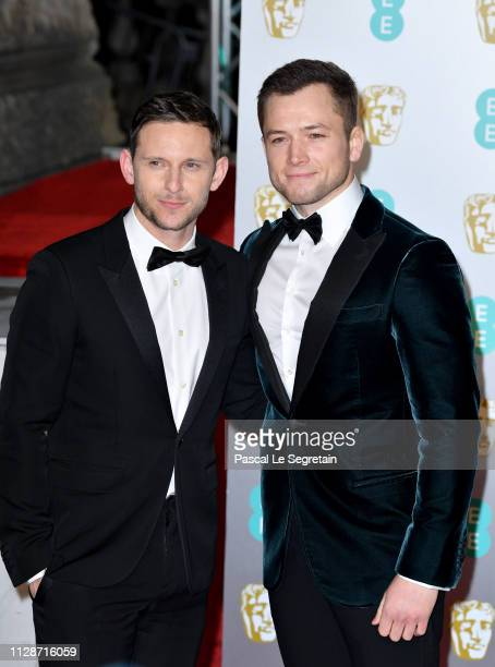 Taron Egerton and Jamie Bell attend the EE British Academy Film Awards at Royal Albert Hall on February 10 2019 in London England