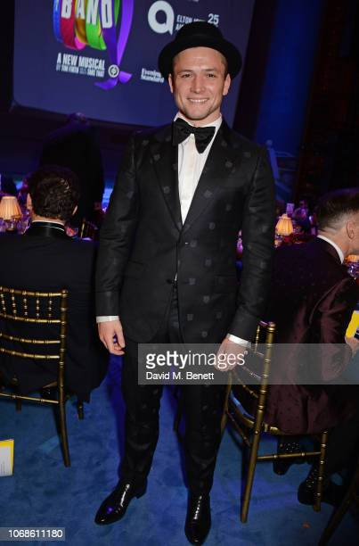 "Taron Egerton attends the Opening Night Gala of ""The Band"" to benefit the Elton John AIDS Foundation supported by The Evening Standard at Theatre..."
