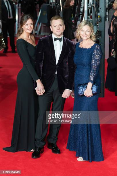 Taron Egerton Emily Thomas and Christine Egerton attend the EE British Academy Film Awards ceremony at the Royal Albert Hall on 02 February 2020 in...