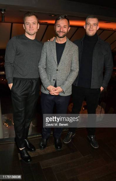 Taron Egerton MR PORTER Brand And Content Director Jeremy Langmead and Russell Tovey attend the launch of the MR PORTER charitable fund The MR PORTER...