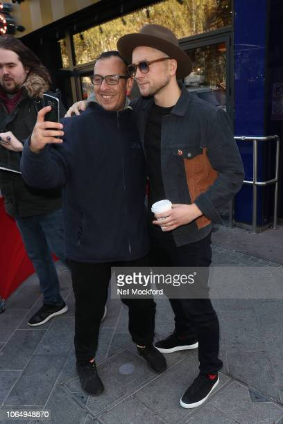Taron Egerton poses with a fan at Global Radio Studios on November 08 2018 in London England