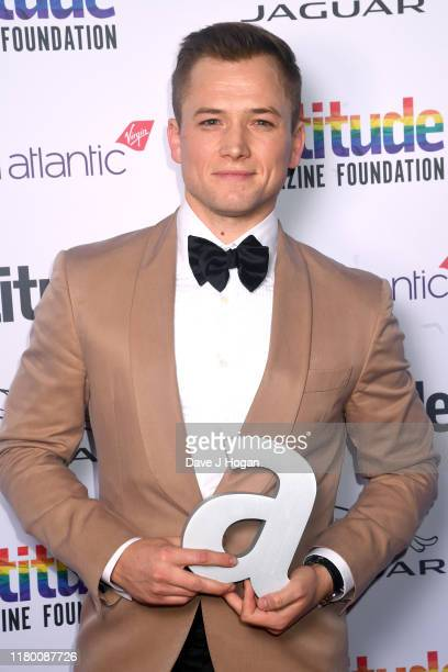 Taron Egerton poses with the Attitude Film Award at the Attitude Awards 2019 at The Roundhouse on October 09 2019 in London England