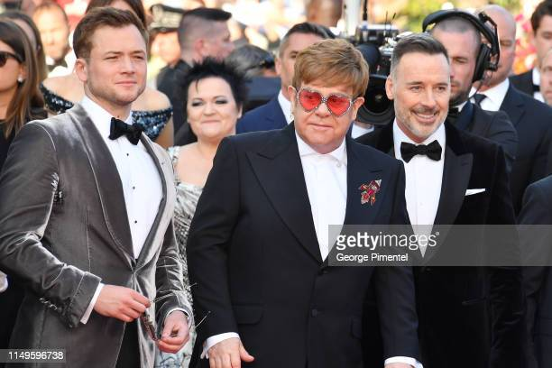 """Taron Egerton, Sir Elton John and David Furnish attend the screening of """"Rocketman"""" during the 72nd annual Cannes Film Festival on May 16, 2019 in..."""