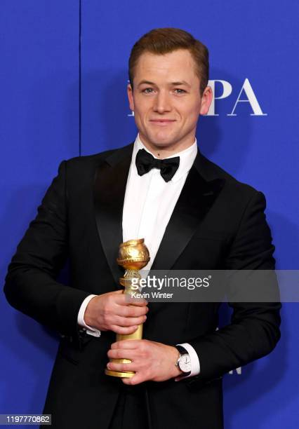 Taron Egerton winner of Best Performance by an Actor in a Motion Picture Musical or Comedy for Rocketman poses in the press room during the 77th...