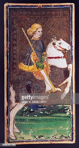 Tarot card depicting the Knight of wands from the PierpontMorgan deck workshop of Bonifacio Bembo Italy 15th century