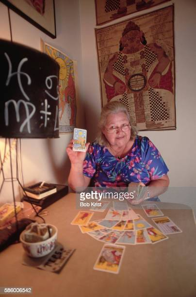 Tarot Card Reader Displaying Card Knowingly