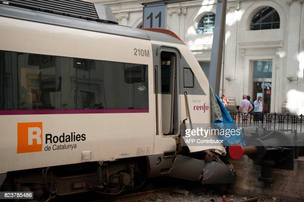 A tarp covers the damaged front end of a train at Estacio de Franca in central Barcelona on July 28 2017 after the regional train appears to have hit...
