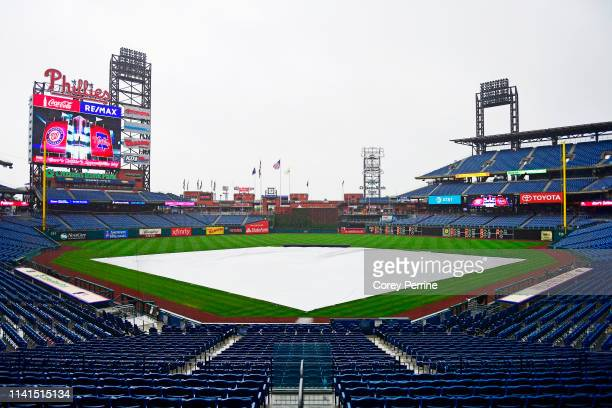 Tarp covers the infield as it rains before the game between the Philadelphia Phillies and the Washington Nationals at Citizens Bank Park on May 5,...