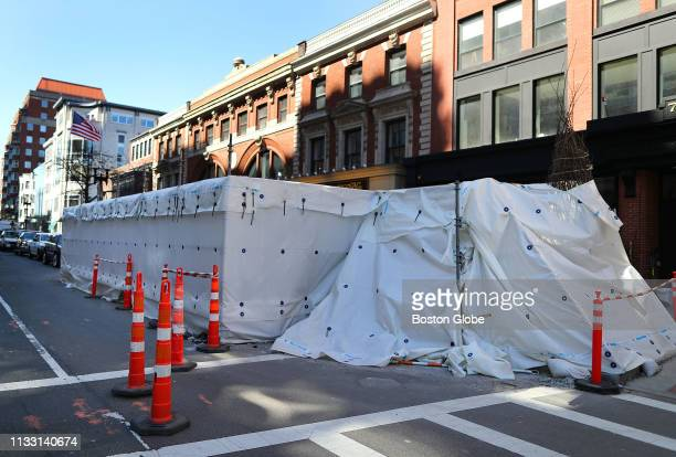 A tarp covers the work being done at the second bombing site on Boylston Street where the Forum stood on a memorial to the victims of the 2013 Boston...