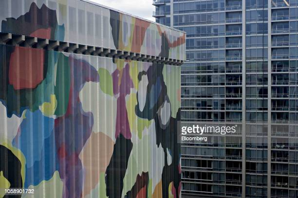 A tarp drapes the 1851 S Bell Street building left in the Crystal City area of Arlington Virginia US on Wednesday Nov 7 2018 Seattlebased Amazon Inc...