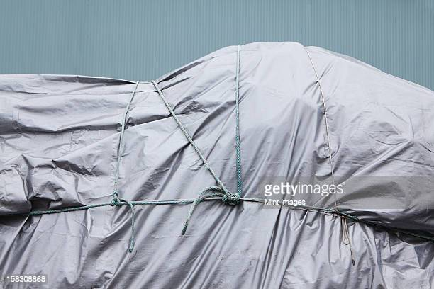 Tarpaulin and rope covering commercial fishing nets, Fisherman's Terminal, Seattle, USA