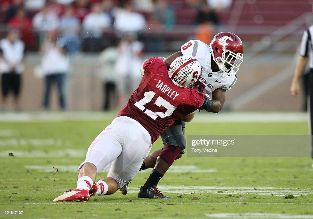 A.J. Tarpley #17 of the Stanford Cardinal tackles Carl Winston #3 of the Washington State Cougars after a reception in the third quarter at Stanford Stadium on October 27, 2012 in Palo Alto, California.