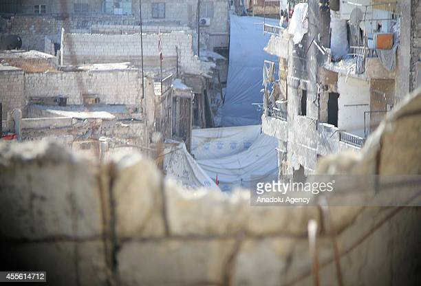 Tarps are stretched to be protected from snipers during the clashes between troops of Islamic Front and Syrian regime forces in Bab alHadid district...