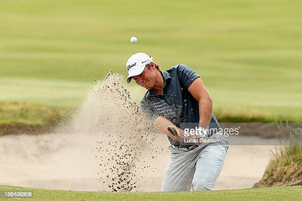 Tarquin MacManus of Australia plays a shot out of the bunker during day one of the Australian Masters at Kingston Heath Golf Club on November 15,...