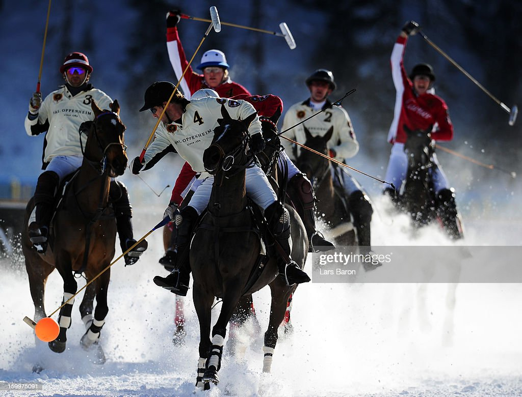 Tarquin Southwell of Great Britain and SAL Oppenheim hits the ball during the Polo World Cup on Snow match between team SAL Oppenheim and team Cartier on the frozen Lake St Moritz on January 24, 2013 in St Moritz, Switzerland.