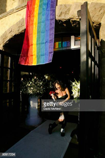 Tarra Berlegeay shows off her boots and garters under a rainbow flag while waiting for her partner to arrive so they can participate in a symbolic...