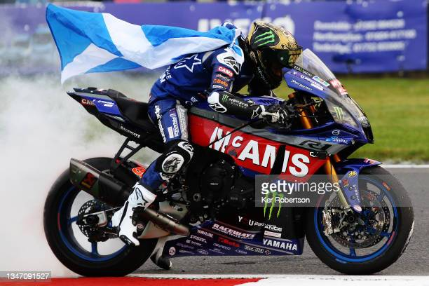 Tarran Mackenzie of Great Britain and McAMS Yamaha does a burnout after clinching the 2021 British Superbike Championship at Brands Hatch on October...