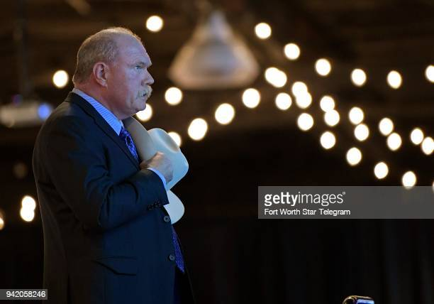Tarrant County Sheriff Bill Waybourn takes off his hat during the singing of the national anthem before a reelection campaign event for Sen Ted Cruz...