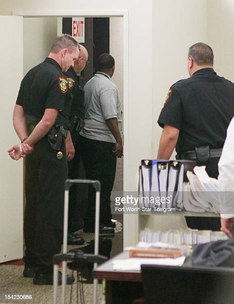 Tarrant County Sheriff's deputies fill the courtroom after Steven Lawayne Nelson damaged a fire sprinkler in his holding cell flooding the courtroom...