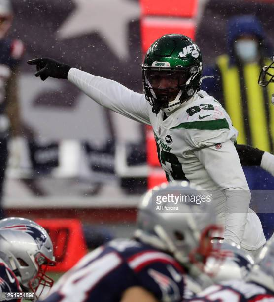 Tarrell Basham of the New York Jets directs the defense in the game against the New England Patriots at Gillette Stadium on January 3, 2021 in...