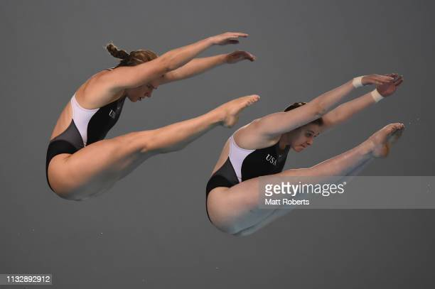 Tarrin Gilliland and Katrina Young of USA compete during the Women's 10m Synchro Platform Final on day one of the FINA Diving World Cup Sagamihara at...