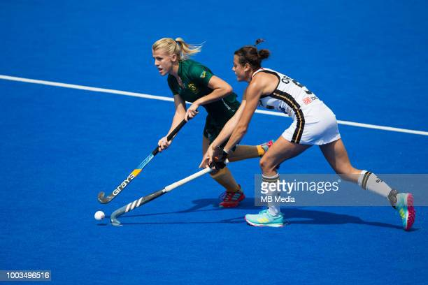 Tarryn Glasby of South Africa holds off the challenge of Selin Oruz of Germany during the Pool C game between Germany and South Africa of the FIH...