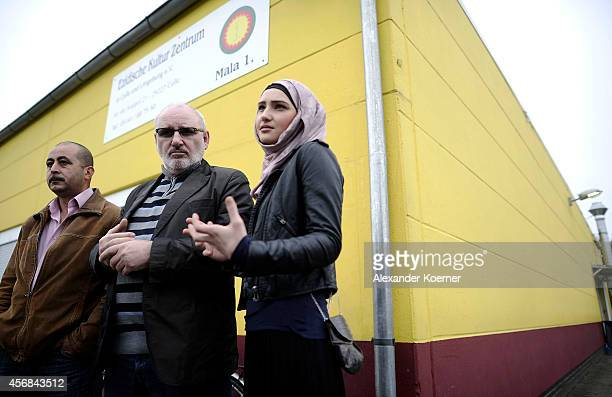 Tarsin Epik dean of the Yazidi community Celle Zaliakan Kharatschov and Sulidian Kharatschonwa of the Chechen commnunity of Celle talk to members of...